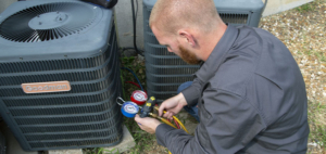 Worker fixing an HVAC unit