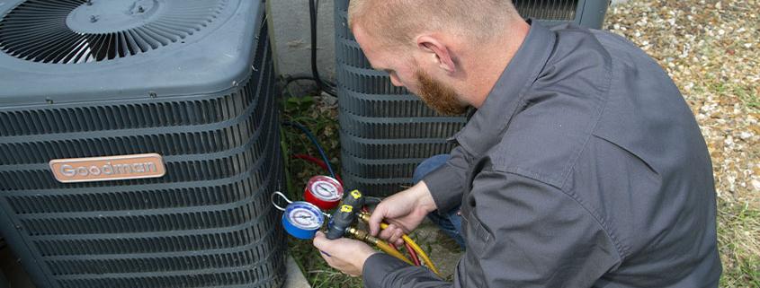 Worker fixing an HVAC unit