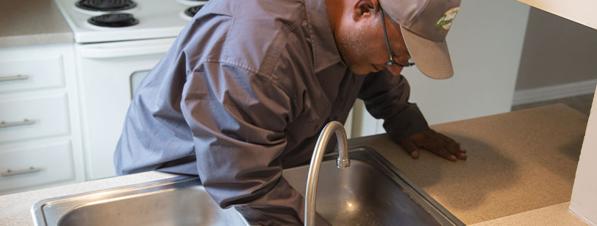 Worker fixing a sink
